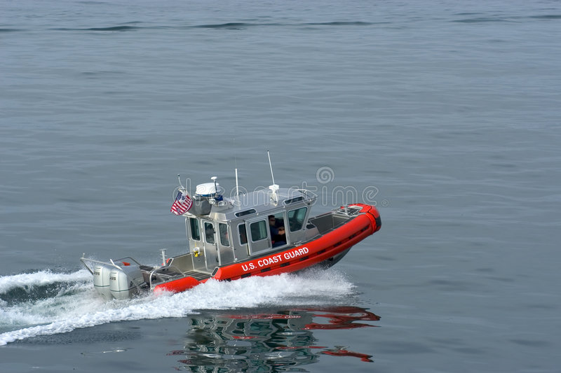 US Coast Guards. Guarding international ferry from Washington state to British Columbia stock images