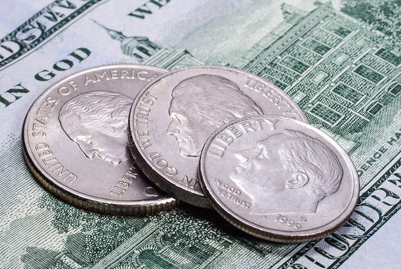 US coins on the hundred dollars banknote royalty free stock photo