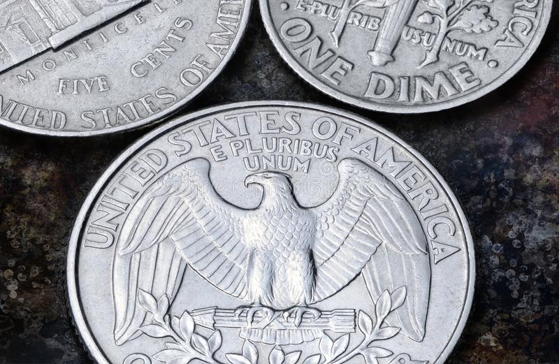 US coins of quarter dollar, one dime and five cents royalty free stock image