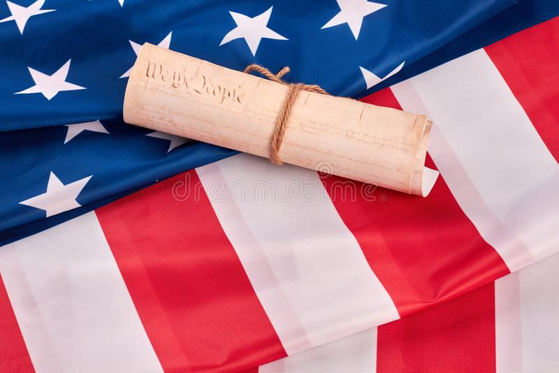 US Constitution on national flag of USA. United States constitution with american flag. Declaration of Independence of the USA stock images