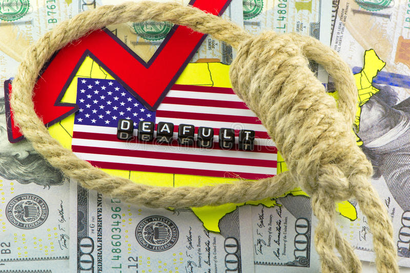 US default trapped. On money background royalty free stock photo