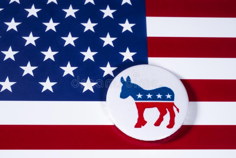 The US Democrat Party. LONDON, UK - DECEMBER 18TH 2017: The Donkey symbol of the Democrat Party, with the American flag behind it, on 18th December 2017 royalty free stock images