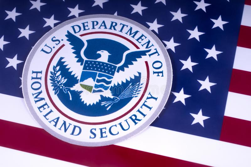 US Department of Homeland Security. LONDON, UK - MARCH 18TH 2018: The symbol of the US Department of Homeland Security pictured over the USA Flag, on 18th March stock image