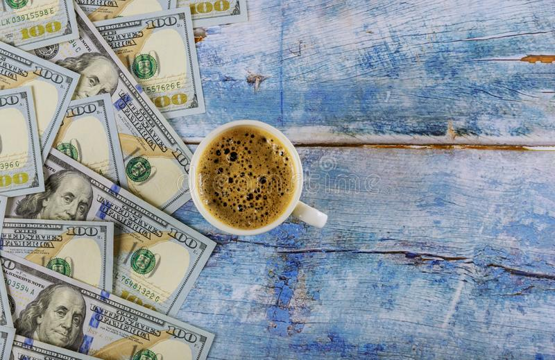 US dollar banknotes american dollars and cup of black coffee on rustic table, top view royalty free stock images