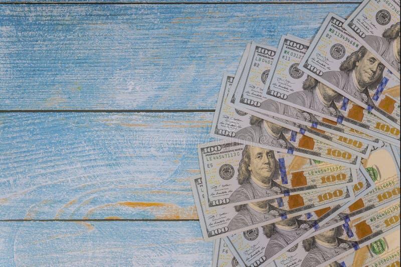 US 100 dollar bill on blue background. US 100 dollar bill on blue wooden background, money, bills, green, currency, hundred, number, wealth, cash, business stock images
