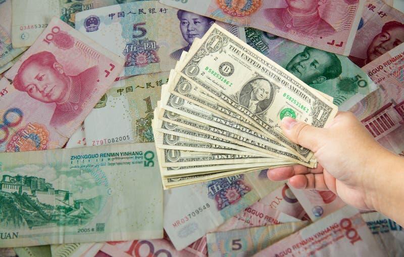 US dollar bill and Chinese yuan banknote. USA war China. stock image