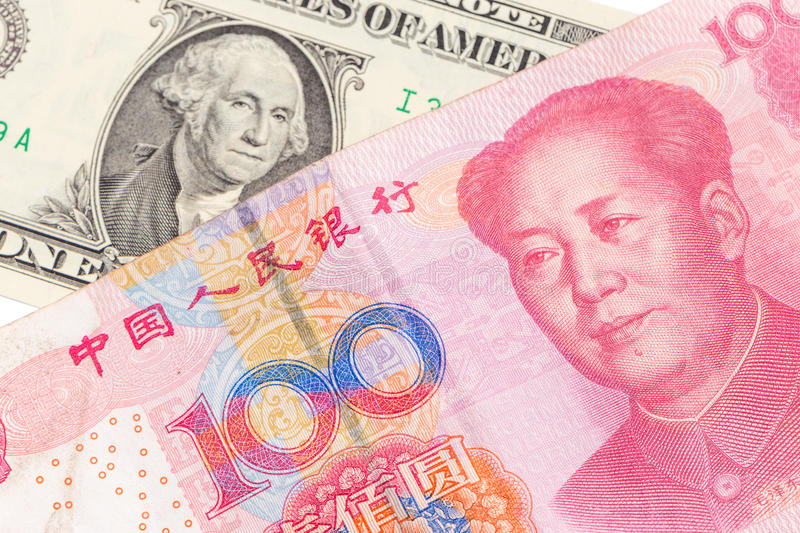 US dollar bill and Chinese yuan banknote on white background, US royalty free stock photo