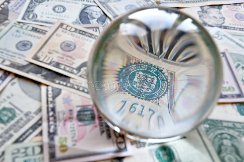 US dollar bill seen through a crystal ball. Creative concept, business, banking, taxes and finance.  stock images