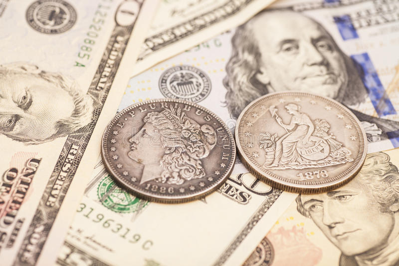US dollar bills and coins. Isolated stock photo