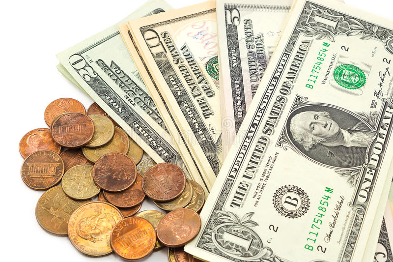 Us dollar bills and coins on white background. Closeup US dollar bills and coins on white background stock image