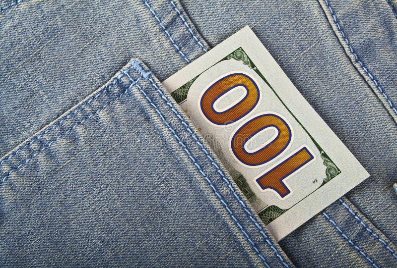 US Dollar cash in jeans pocket stock image