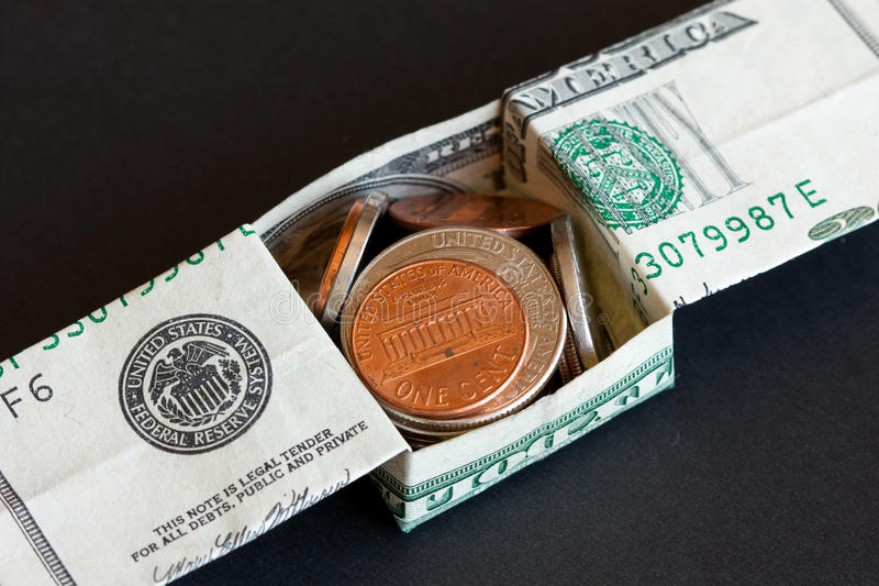 US Dollar And Coins Royalty Free Stock Photography