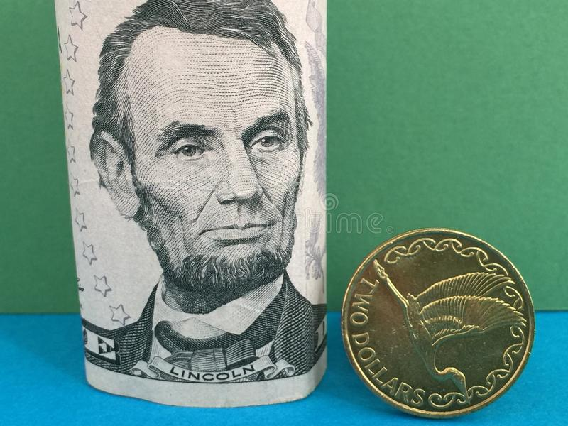 US dollar för nyazeeländsk dollar kontra royaltyfri bild