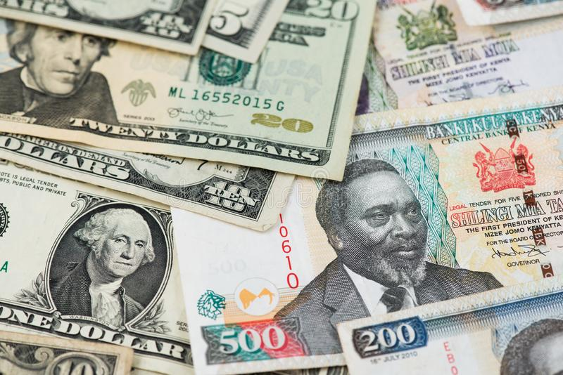 US Dollar and Kenyan Shilling Banknotes. USA Africa Money. US Dollar and Kenyan Shilling Banknotes. Africa Kenya Shilling USA Dollar Money royalty free stock photo