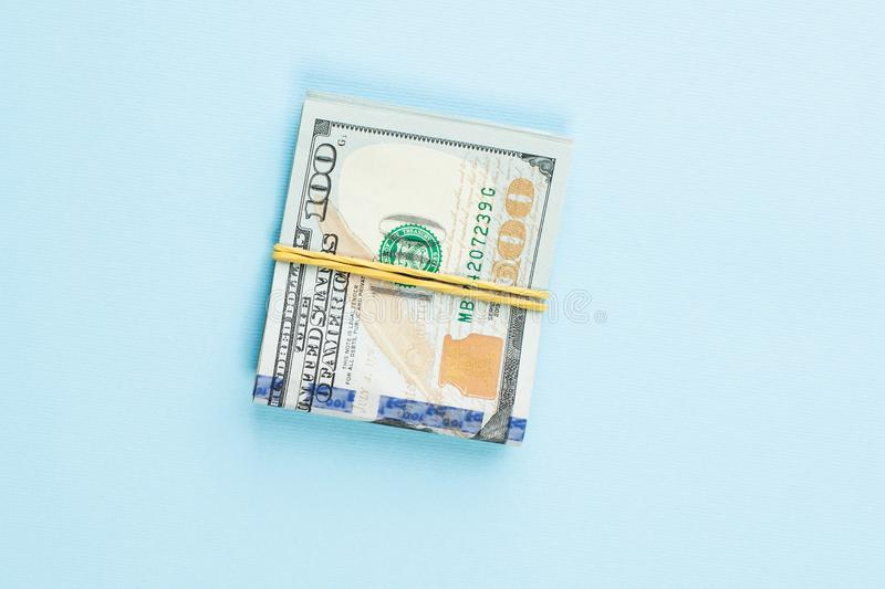 100 US dollar money cash on blue table background.  royalty free stock image