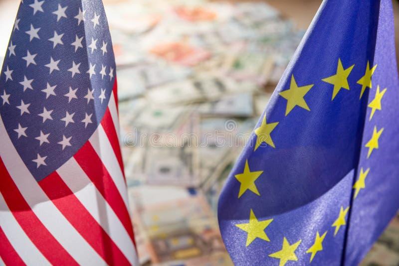 US dollar och euro på flaggor royaltyfri foto
