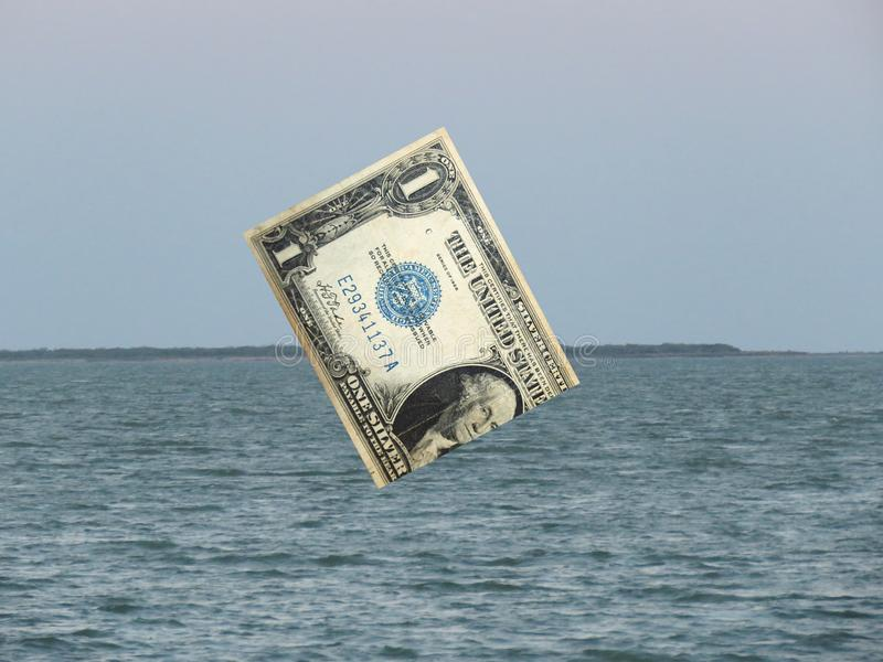 US Dollar Sinking in the Sea of Global Markets royalty free stock photo