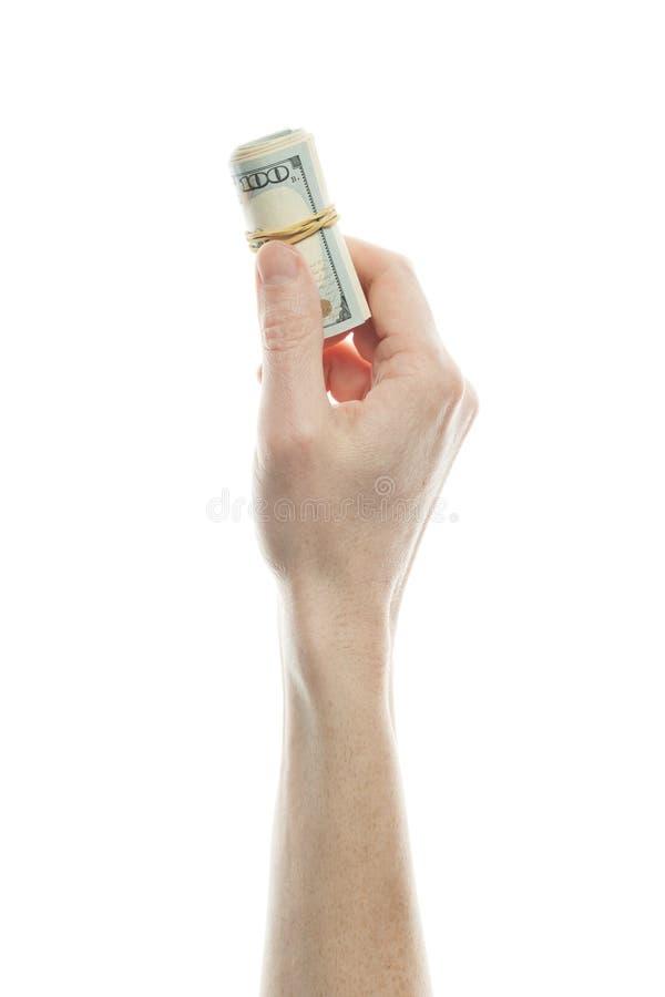 US dollar som föreställer investeringar för rikedom och rikedom Rulle av anmärkning 100 mans in handen som isoleras på vit bakgru royaltyfria bilder