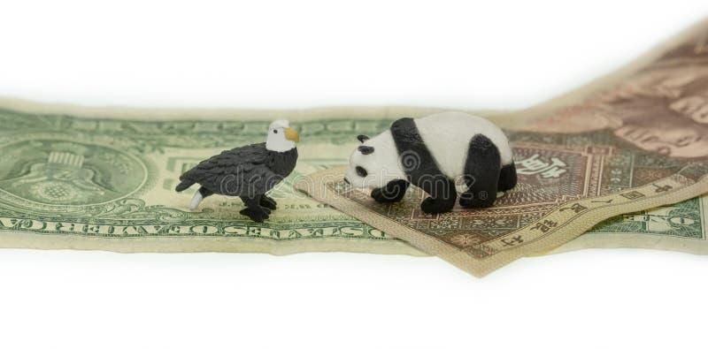 US dollar versus China Yuan conflict symbols royalty free stock photo