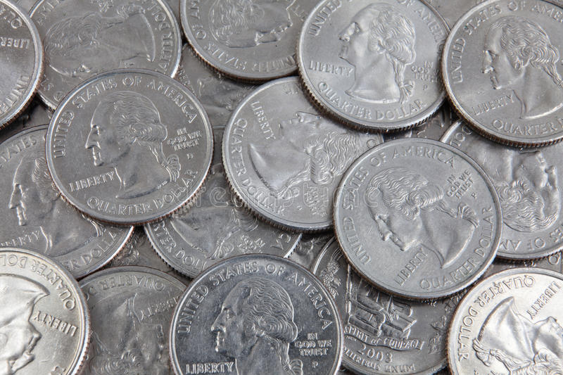 US dollars. A lot of US quarter dollar coins stock photography