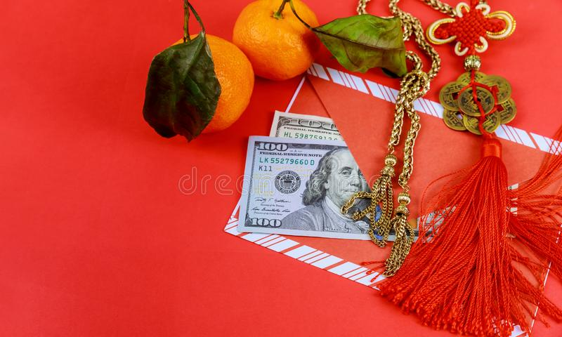 US dollars banknotes with red envelope in Chinese New Year royalty free stock photo