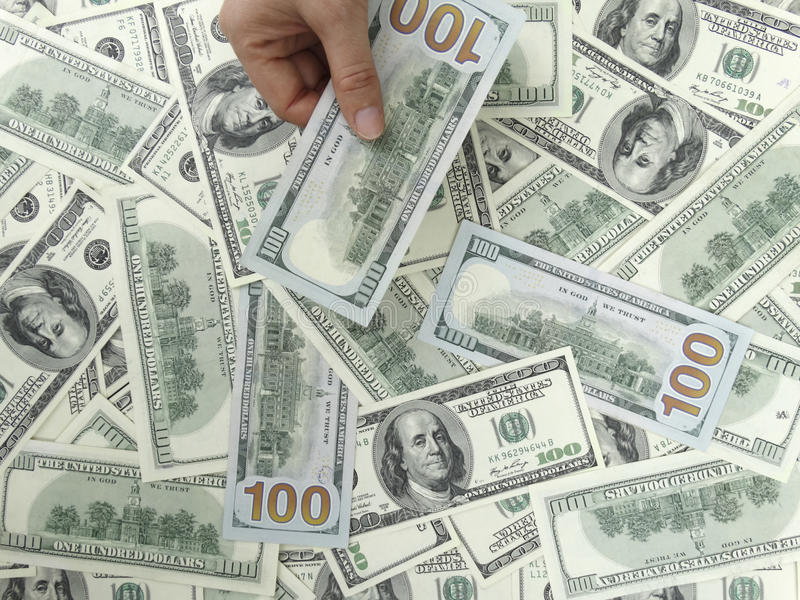 Download US 100 Dollars Bills With 1 Hand Stock Photo - Image: 36676062