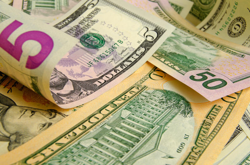 US dollars. Cash dollars lying on the plane royalty free stock images