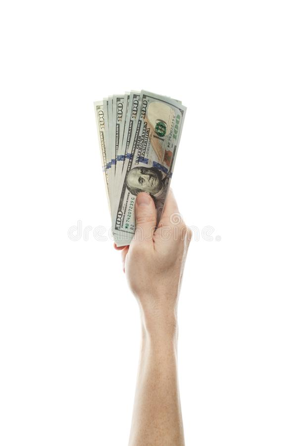 US dollars cash money and male hand isolated on white background. Modern American Dollars 100 banknote in hand up stock image