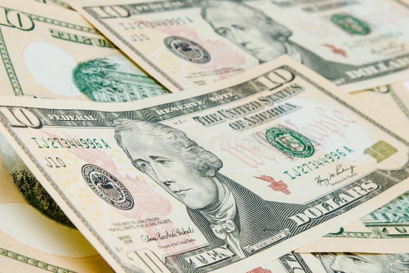 Geldhintergrund mit US-Dollar Rechnungen stockbild