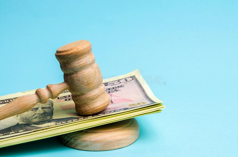 US dollars and judge`s hammer / gavel. The concept of corruption in the state and government. Court. Bankruptcy, Bribery, Fraud,. Crime. Corruption problem in royalty free stock photo