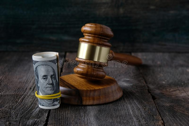 US dollars and the judges gavel. royalty free stock photos