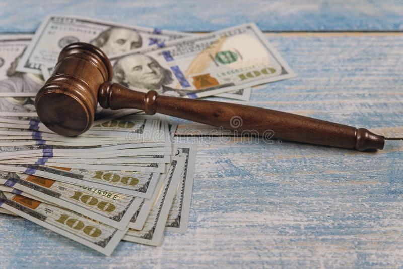 US dollars and on law hammer of the judge corruption, money financial crime. US dollars and on law hammer of the judge for dispensing justice corruption, money stock photo