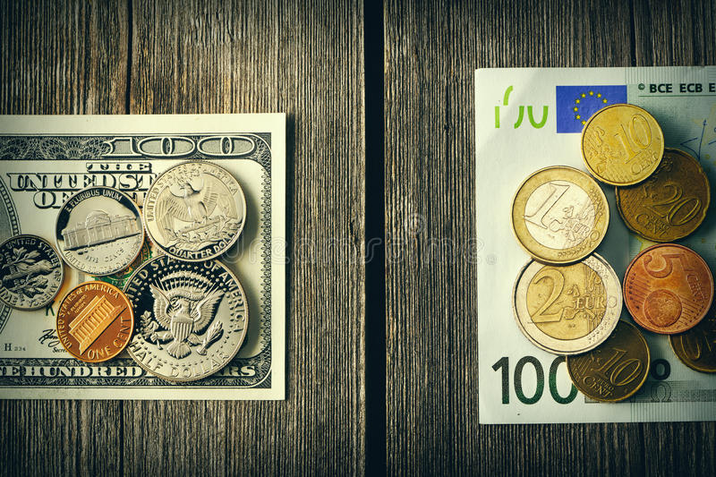 US and euro money over wooden background stock image