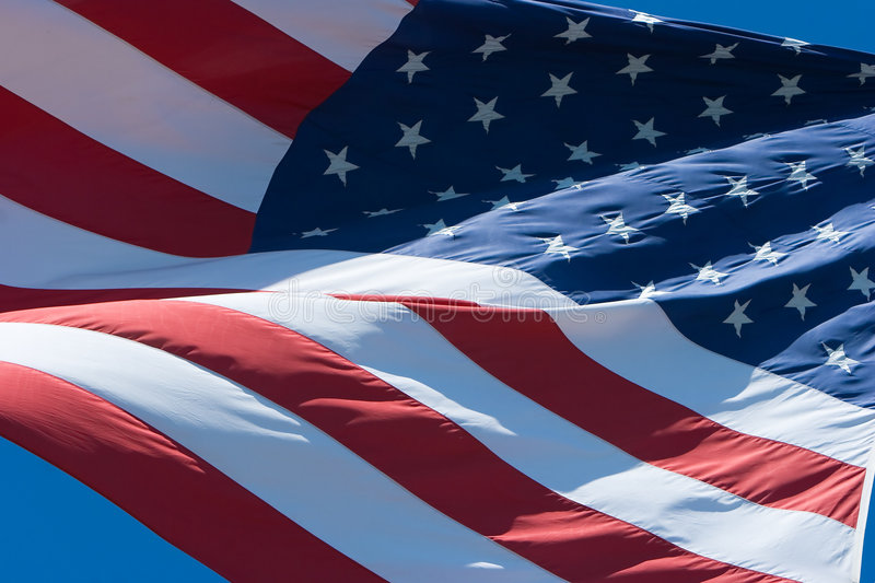 US flag. Flapping in a light breeze on a clear sunny day stock images