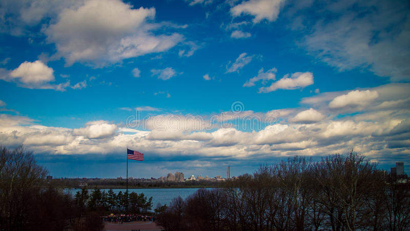 US flag on Ellis Island. With a clouds behind it royalty free stock images