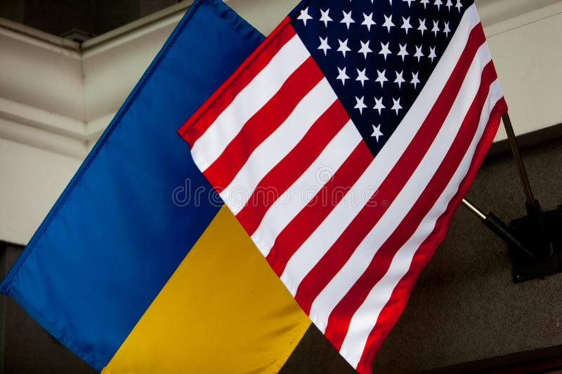 The US flag and the flag of Ukraine hang on the flagstaff. Horizontal shot. The US flag and the flag of Ukraine hang on the flagstaff. Horizontal shot royalty free stock photo