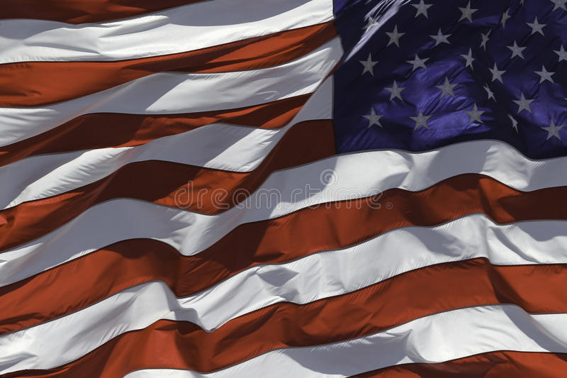 US Flag. Fluttering in the wind royalty free stock photography