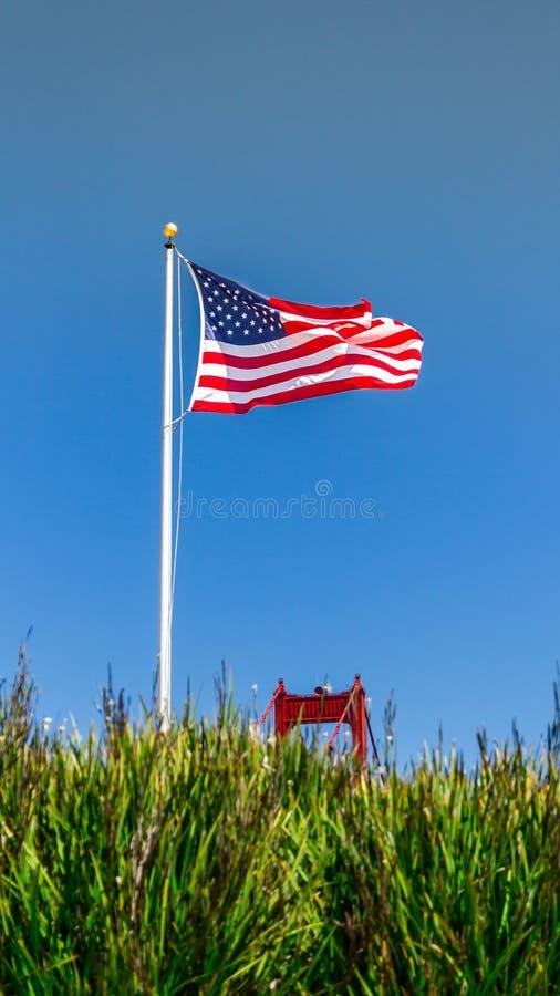 US Flag and Golden Gate Bridge stock photo