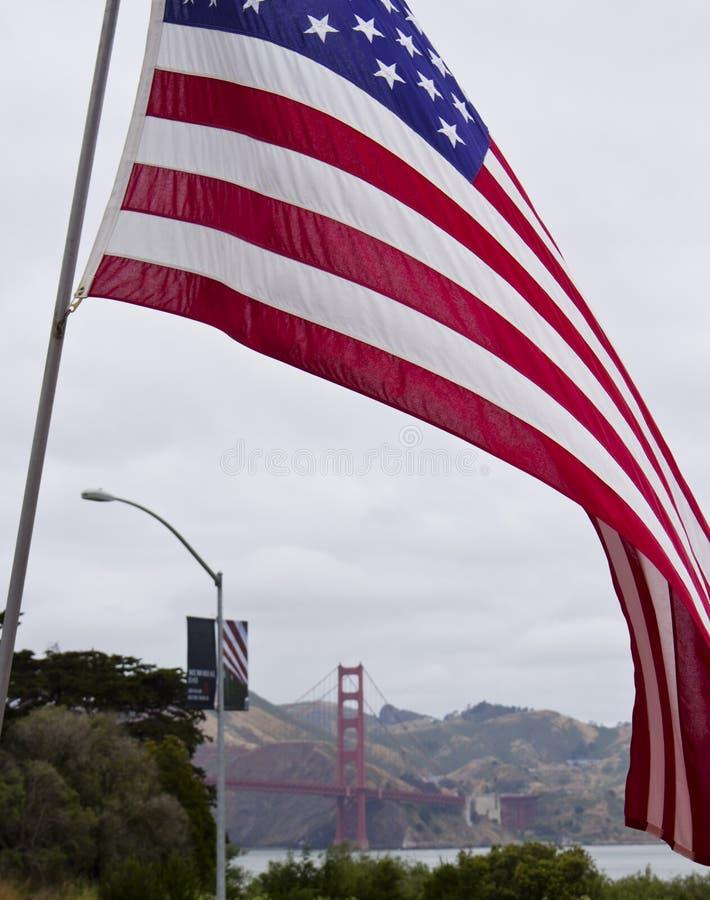 US Flag & Golden Gate Bridge royalty free stock photos