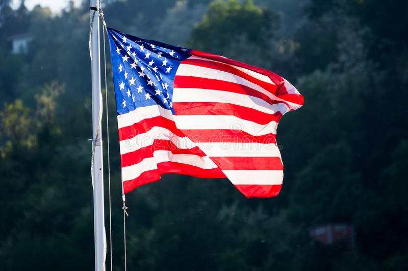 US flag and green in backgroud. The US flag and green in backgroud royalty free stock photos
