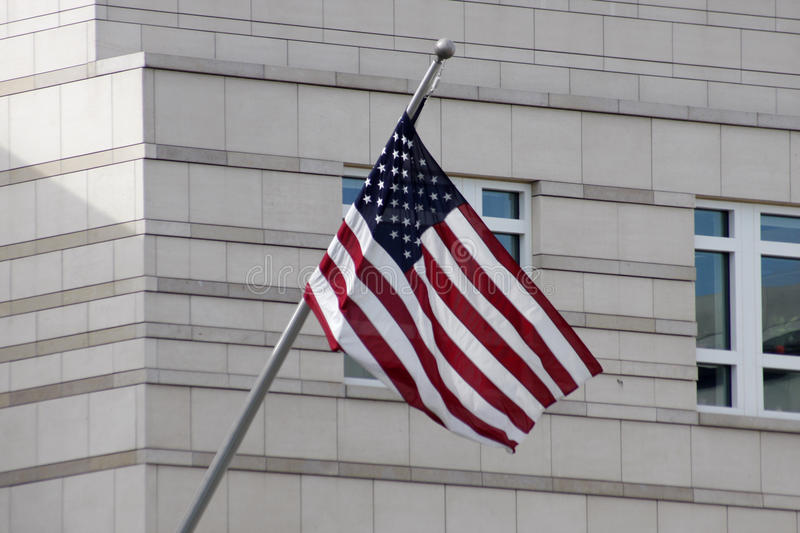 US flag. JUNE 2011 - BERLIN: the US American flag in front of the American Embassy on the Pariser Platz in Berlin-Mitte stock photography