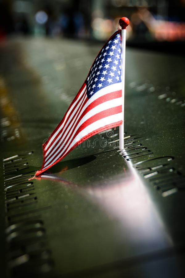 A US flag at the 9/11 memorial, New York stock images