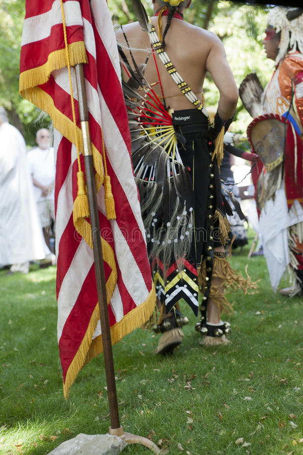 The US flag and Native Americans. Native Americans at the feast of assumption at Cataldo, Idaho on August 15, 2013 stock image