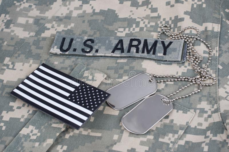 US flag patch with dog tag on Army Combat Uniform. Background royalty free stock images