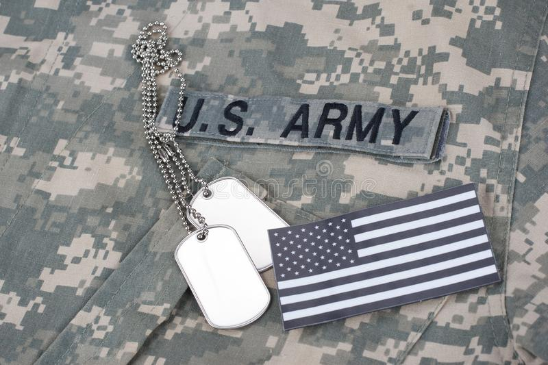 US flag patch with dog tag on Army Combat Uniform. Background royalty free stock photography