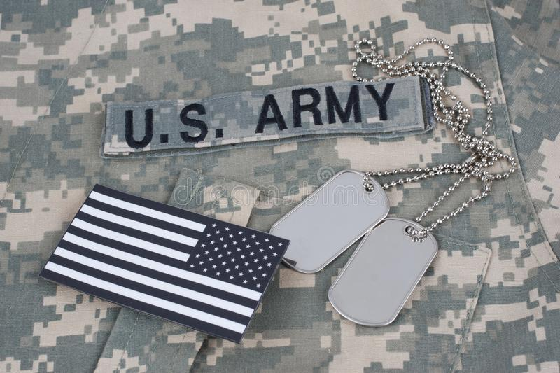 US flag patch with dog tag on Army Combat Uniform. Background stock photography