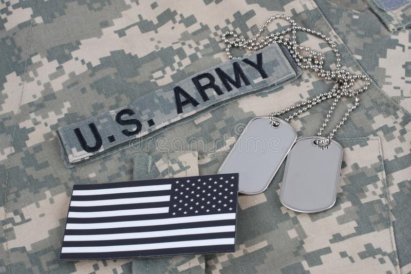 US flag patch with dog tag on Army Combat Uniform. Background royalty free stock photos