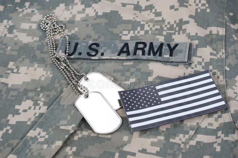US flag patch with dog tag on Army Combat Uniform. Background royalty free stock photo