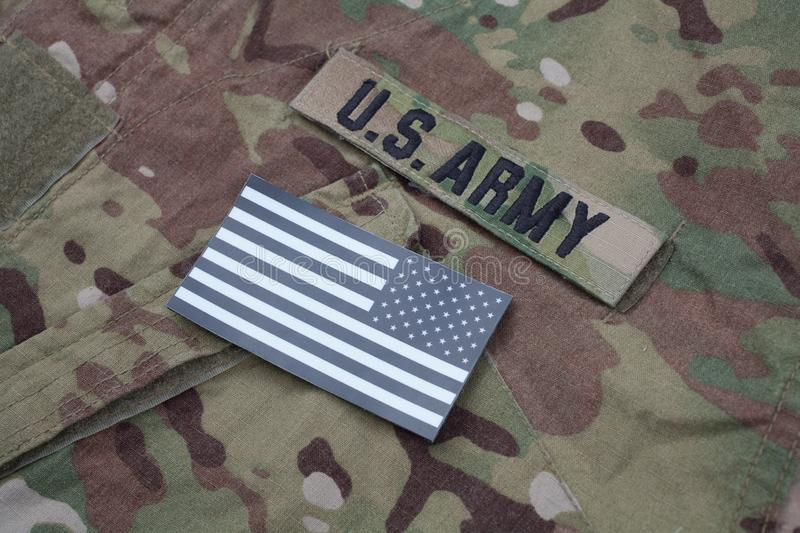 US flag patch with dog tag on US ARMY multicam uniform. US flag patch with dog tag on US ARMY multicam camouflage uniform royalty free stock photos