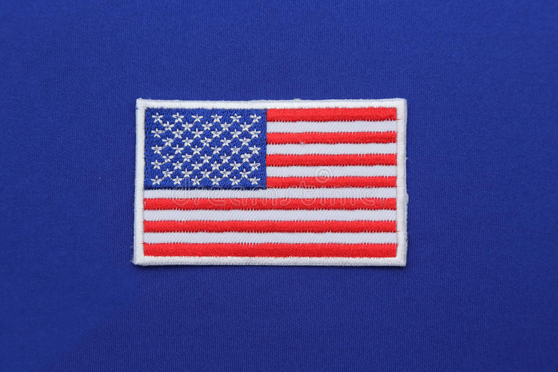 Us flag patch on fabric. Us flag patch on blue fabric royalty free stock photography